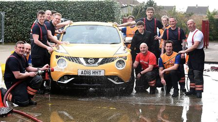 Charity car wash by Wisbech fire crew alongside students from the Colege of West Anglia Picture: IAN