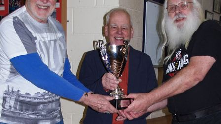 The presentation of the four-way battle trophy: Roger Newark LRPS.CPAGB, chairman of the Wisbech Cam