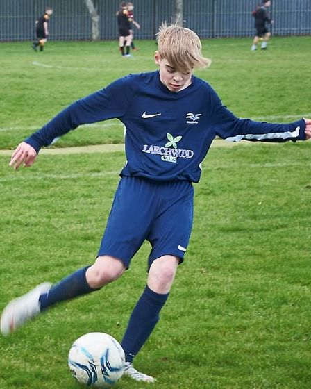 Wisbech care home Three Dove Court has sponsored football kits for Thomas Clarkson Academy's Year 9