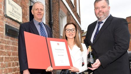 Hannah Shales with her certificate and a bottle of champagne with Wisbech Partners, Richard Meadows