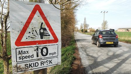 A sign warns drivers of the risk of skidding near the crash scene on Magdalen High Road, at St Germa