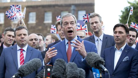 Arron Banks (L) and Andy Wigmore (R) as Nigel Farage gives a press conference at College Green after