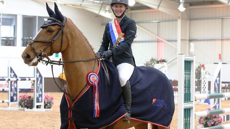 Stacey Cook with her prize-winning horse Ninola at the British Showjumping Spring Championships in B