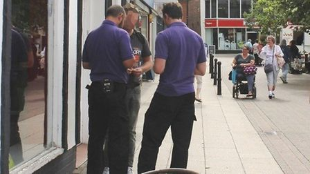 Enforcement officials from Kingdom checking out a suspected offender for littering in Wisbech. Part