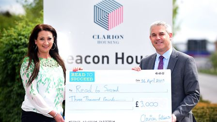 Maria Walker (left) of Clarion Futures handing over £3,000 to Steve Barclay (right) for his Read to