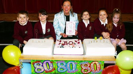 Welwyn St Mary's School head Mary Westley celebrates the 80th birthday of their main building with p