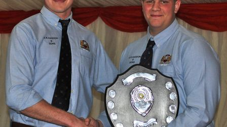 Luke Green (R) recieving the most promising Young Player of the Year award - Award winners collectin