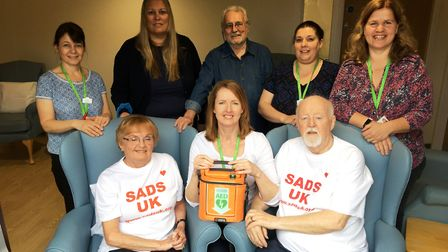 Ian and Evelyn Duffy donate a defibrillator to the Alan Hudson Centre, Wisbech, in memory of their d