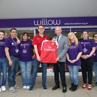 Former Arsenal goalkeeper Bob Wilson with volunteers at the Arsenal Foundation takeover of the Willo