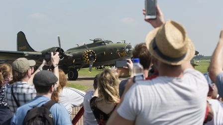 Crowds at the Duxford Air Festival in 2018 gather to watch 'Sally B', Europe's last airworthy B-17 F