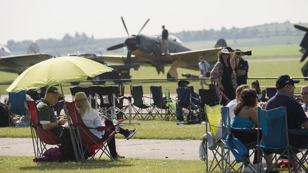 Visitors enjoy the warm weather at the Duxford Air Festival in 2018. Visit IWM Duxford this Spring