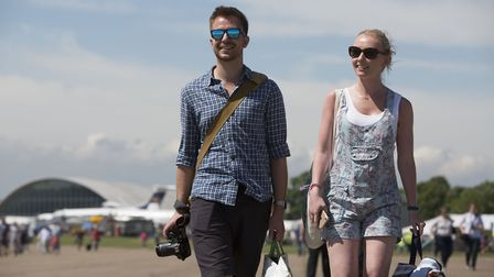 A young couple enjoy a day out at the 2017 Duxford Air Festival. Visit IWM Duxford this Spring Bank