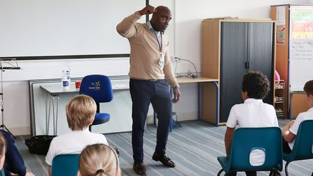 Anthony explains to the children how he got out of the crime lifestyle. Picture: DANNY LOO