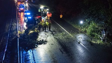 The police car, pictured bottom right, crashed on the A1(M) last night. Picture: Peter Gill