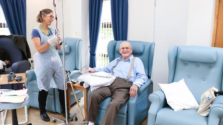 Staff nurse Jane Clarke prepares a patient to receive treatment in the newly refurbished Alan Hudson