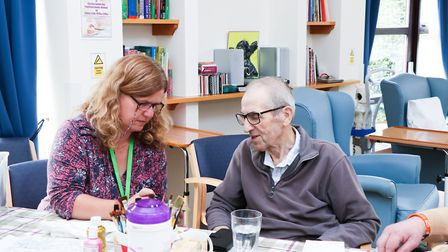 Judi Duffy (Creative Activities Coordinator) with a patient who attends the Treatment Centre's weekl