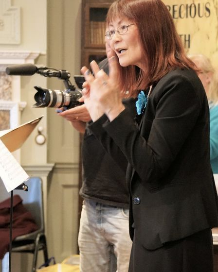 Film captures the stories of migrants in Fenland: Loc-Mai Yuen-Brooker conducting. Picture: PETER KI