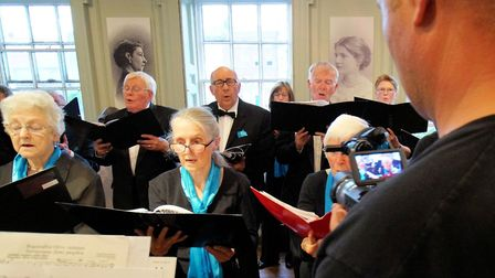 Film captures the stories of migrants in Fenland: choir members singing for the camera. Picture: PET