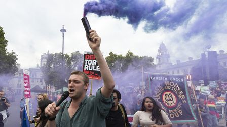 People gather to protest against British prime minister Boris Johnson's policies on Brexit and the p