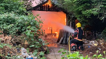 Blaze destroys shed in the grounds of Wisbech's oldest house. Picture: @FENCOPS