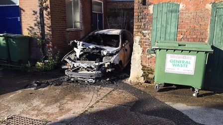 Burnt out Jaguar. One of the targets for an arsonist in Wisbech this week. A man has been arrested.