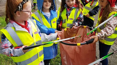 Inspirational youngsters from Parson Drove Rainbows joined up to help with a gigantic litter pick ar