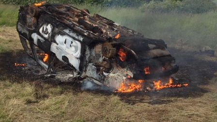 A burnt-out car and another submerged in water were two dramatic incidents attended by firefighters