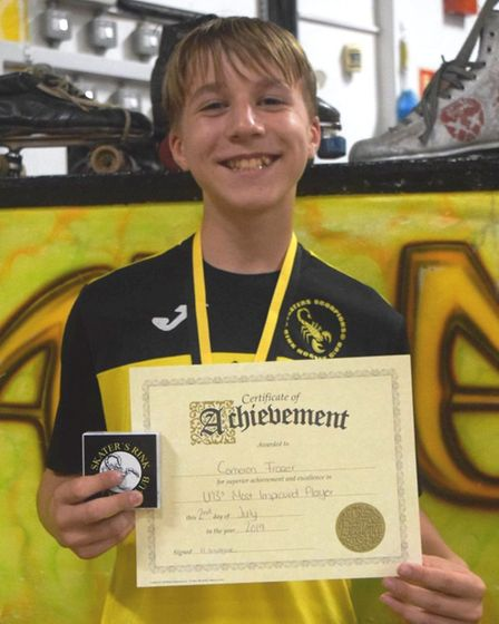 Cameron Fraser after winning the under 13's most improved player award. Picture: JON DAY