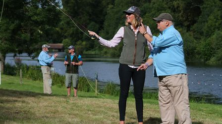 Learning to cast at The Game Fair down by the River Lea. Picture: Philip Hollis