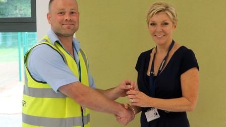 Carrie Norman, the Principal of Peckover Primary School, Wisbech, has officially been handed the key
