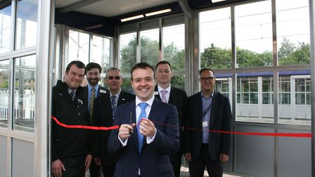 MP Stephen McPartland cuts a ribbon to mark the completion of regeneration work at Knebworth station