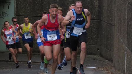 Garden City Runners' Neil Hume powers away from the underpass in the Midweek League Mob Match. Pictu