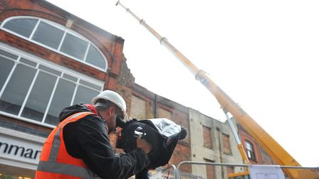 Demolition of a derelict building in Wisbech's High Street has begun and will continue into the week