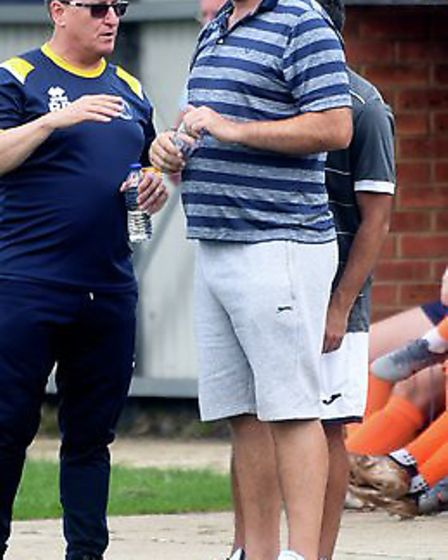 Peter Chilton (right), Wisbech St Mary first-team coach, watches on along with assistant Roy Brand (