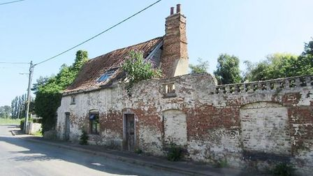 An historic house near Wisbech that half collapsed in the 1970s could be transformed into four homes