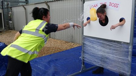 Get in the stocks! Senior staff at DHL in Wisbech were sponged by employees in aid of road safety ch