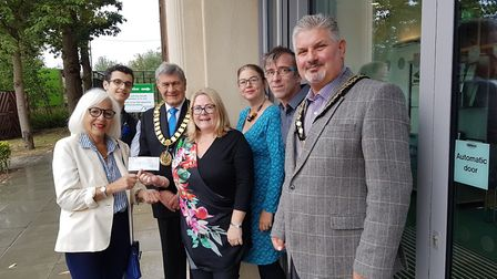 Loekie Wigmore, from Hatfield Rotary Club, hands over a cheque to Angela Gaughan, from Potential Kid