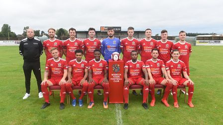Wisbech Town line up for the camera ahead of the new season. Pictured are, back row, left to right,