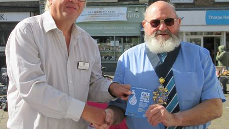 Wisbech Mayor Mike Hill (right) accepts the first #Refill Revolution sticker from Nick Meekins (left