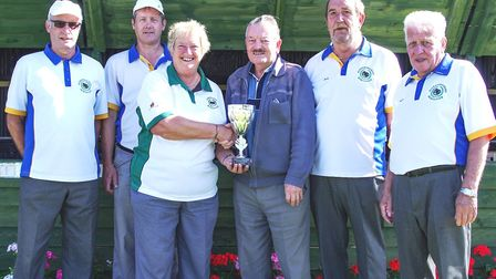 Trophy presentation to members of Wisbech's Alexandra Road Bowls Club after winning Gorefield Bowls