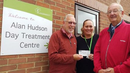 The cheque presentation for the Alan Hudson Day Treatment Centre. Left to right: Paul Bennett of CMB