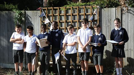 Year six pupils recite a prayer at the opening of St John's School Digswell Sensory and Wellness gar