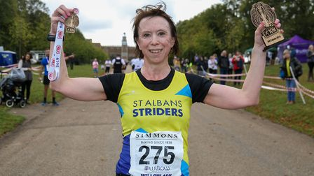 Caroline Bailes with her Willow 10K medal and prize at Hatfield House. Picture: DANNY LOO