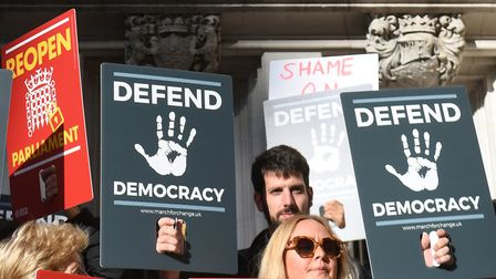 Protesters outside the Supreme Court in London where judges are due to consider legal challenges to
