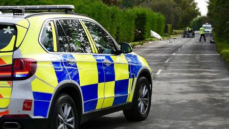 Police remain at the scene of a collision involving a tractor and a car at Outwell Road, Emneth, ear