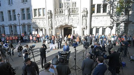Members of the media and protesters outside the Supreme Court in London. Picture: Kirsty O'Connor/PA