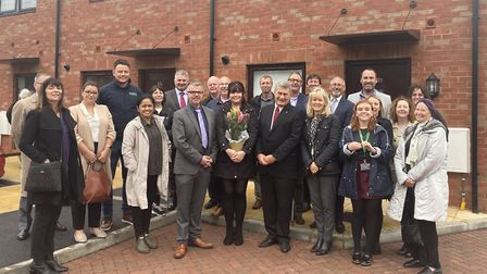 New tenant Stacey with council officers, councillors and FSG staff. PIcture: WHBC.