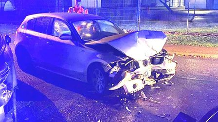 The scene on Ramnoth Road, Wisbech after a driver smashed their BMW 1 Series into two parked cars on