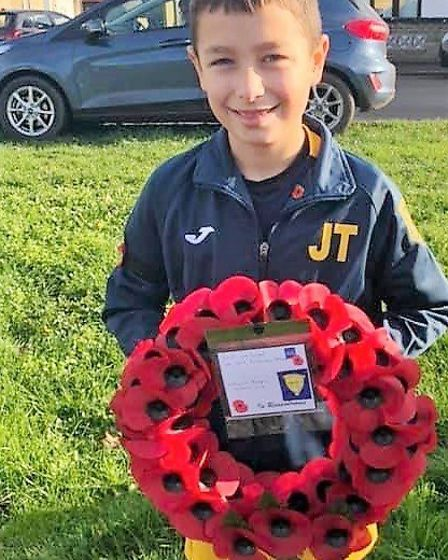 Littleport Rangers FC's Jack Taylor laying the wreath on behalf of the club. Picture: CATHY GIBB-DE
