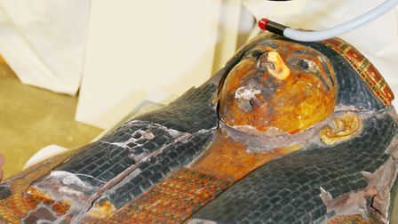 Ancient Egyptian talk for society in Wisbech. Egyptian coffin under examination. Picture: SOCIETY
